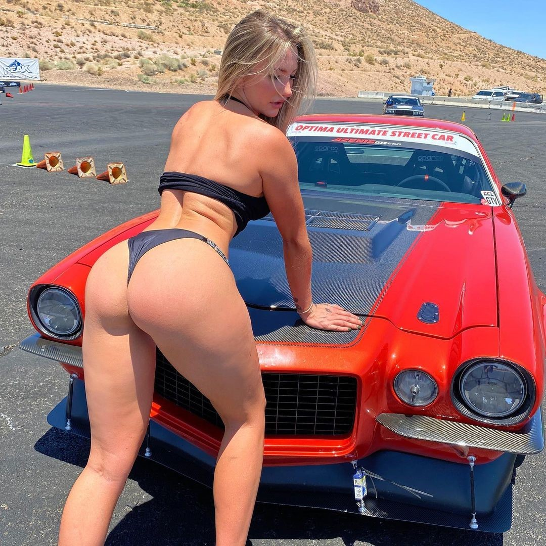 Emily Knight in front of the car